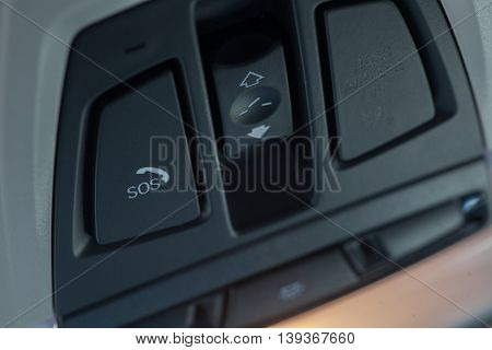 Close up shot of a car's SOS button.