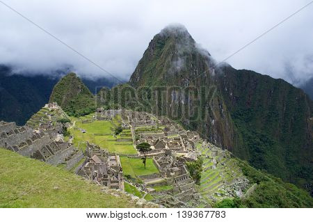 Another from machu picchu with clouds in the sky