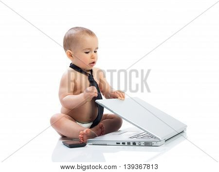 Baby businessman with laptop isolated, close up