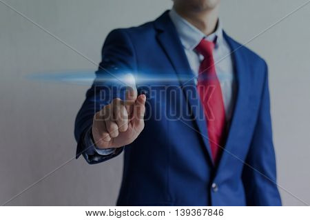 Businessman Touching On Virtual Screen With Blink Of Light