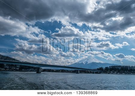 Mt. Fuji with Kawaguchiko Bridge in cloudy day