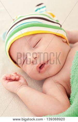 Cute newborn baby's sweet dreams close up