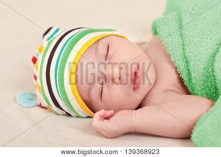 A sleeping cute newborn baby close up