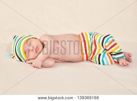 Sleeping cute newborn baby on blanket, close up