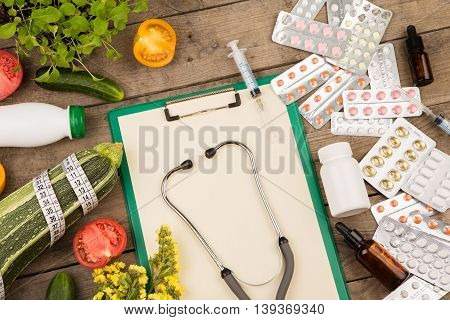 The Choice Between A Healthy Lifestyle And Medications. Vegetables Or Pills: Blank Clipboard, Stetho