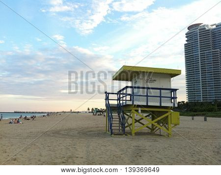 Lifeguard tower during sunset at Miami South Beach with colorful cloud and blue sky