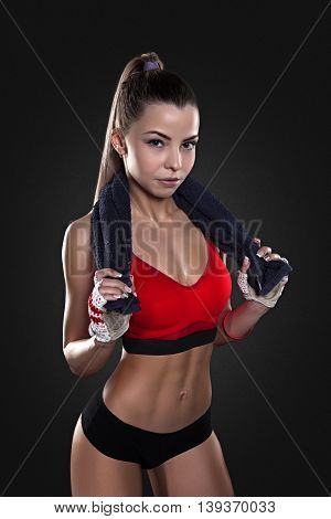 Elegant sports woman after workout with towel. Fitness and beauty, healthy lifestyle.