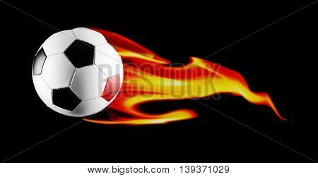 Black and white soccer ball with fire on black background.