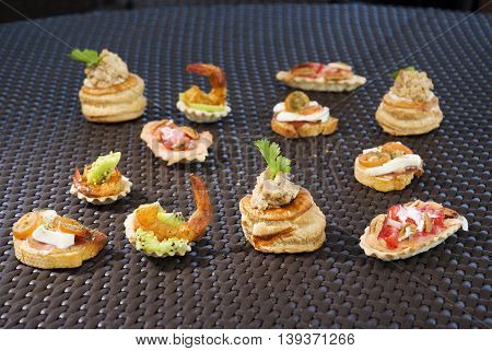Delicious gourmet plate with texture and color. Diferent canapes.