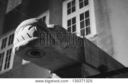 expressive sculpture of stone dragon's heads on the building