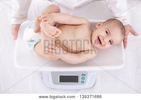 Measuring Smiling Beautiful Comfortable Little Baby
