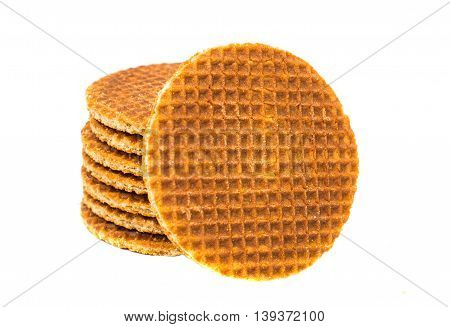 Dutch waffle called a stroopwafel on a white background