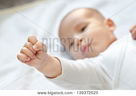 Battle for babies baby showing fist,portrait close up