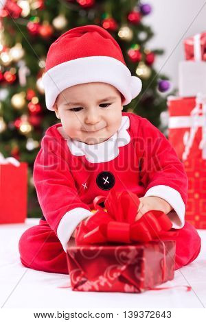 Little baby in santa claus costume, christmas concept