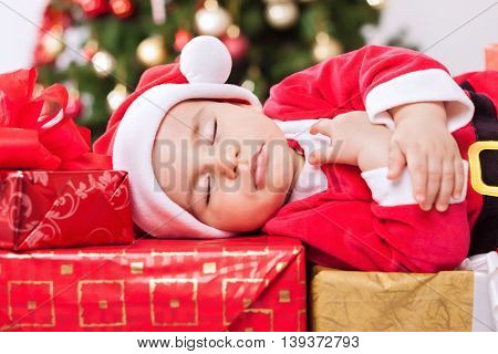 Cute sleeping baby santa boy, christmas concept
