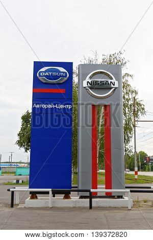 Promotional Stand With Nissan And Datsun Signs Near Selling And Service Center