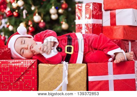 Little Tired Baby Santa Sleeping On Gifts For Christmas