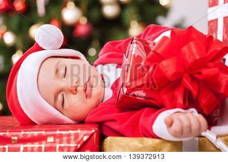 Sleeping Baby Santa Claus Resting On Presents
