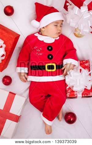 Tired Baby Santa Resting On Presents