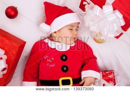 Beautiful baby santa claus sleeping, christmas concept