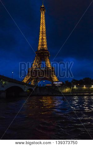 PARIS, FRANCE - MAY 15, 2015: This is view of the top of the Eiffel tower in the night illumination of its backlight.