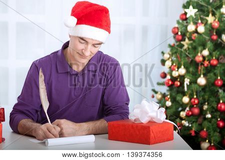 Man writes wishes for christmas holiday, christmas concept