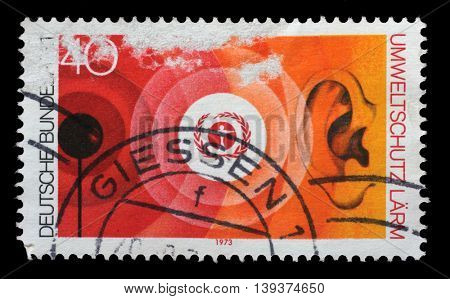 ZAGREB, CROATIA - JULY 03: a stamp printed in the Germany shows Environment Emblem and Noise Pollution, Nature and Environmental Protection, circa 1973, on July 03, 2014, Zagreb, Croatia