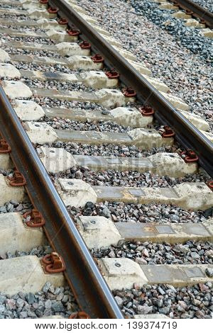The railroad tracks close-up. Vertical image diagonal form.