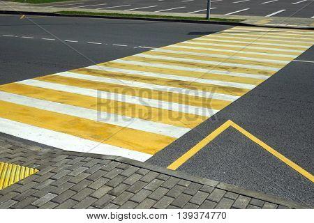 Diagonal view of the road markings crosswalk.
