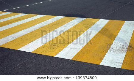 Crosswalk across the street, road markings.