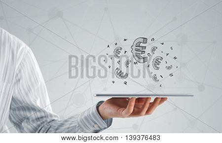Close view of businessman holding tablet pc presenting money earning concept