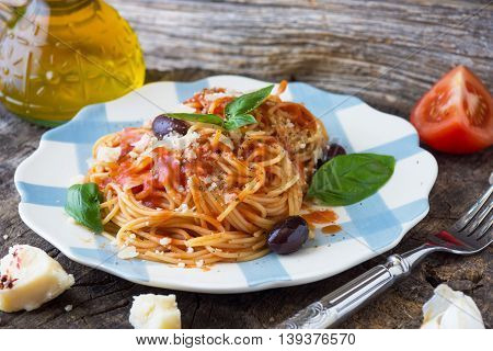 Spaghetti With Tomato Sauce On Wooden Background