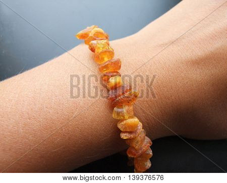 raw amber. Bracelet from amber. decoration.decoration of stones