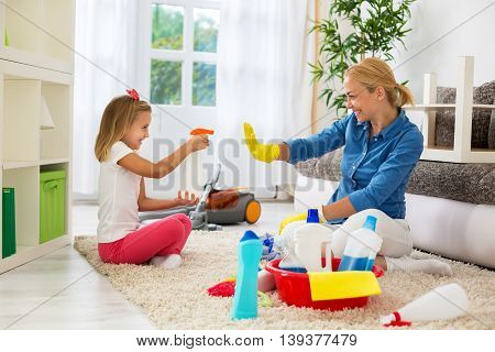 Mother And Child Cleaning Home And Having Fun