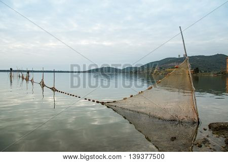 Fishing net inside the lagoon of Orbetello Tuscany Italy