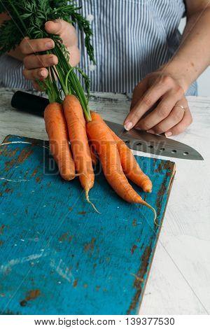 carrots in the hands of women. Fresh summer concept