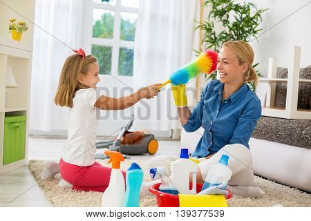 Smiling Woman And Daughter Enjoy To Cleaning House