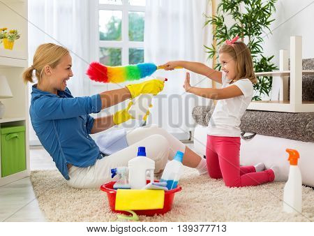 Happy Smiling Mom And Kid Cleaning Room