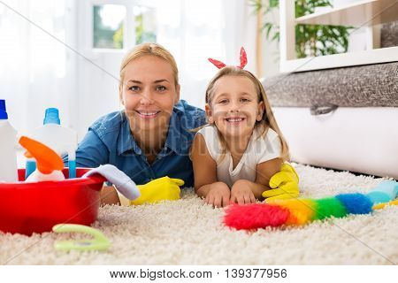 Beautiful Mother With Kid Cleaning Room And Having Fun