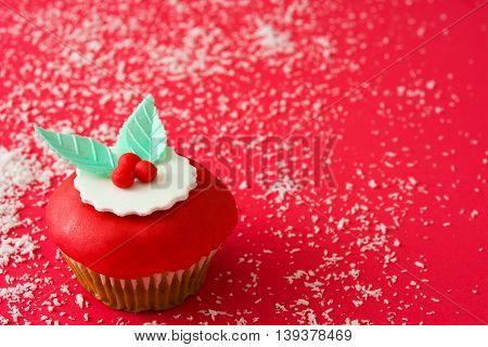 Sweet christmas cupcakes fondant on red background