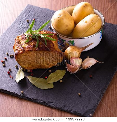 Baked Meat With Vegetble And Herbs On Slate Stone