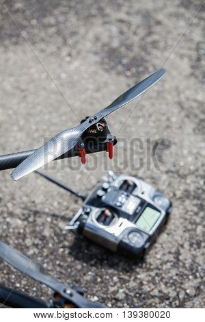 Close up shot of one of the propellers form an octocopter drone with a remote controller.
