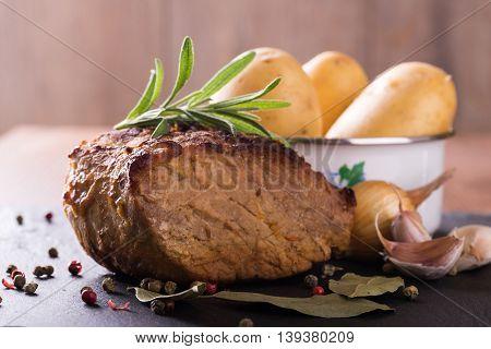 Piece Of Baked Pork Meat On Slate Stone