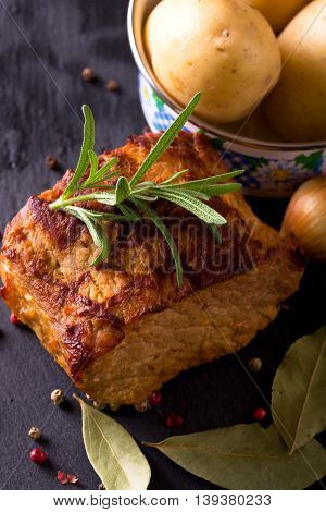 Pork Meat With Herbs And Pepper On Slate Stone