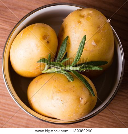 Three Potatoes With Skin In A Pot