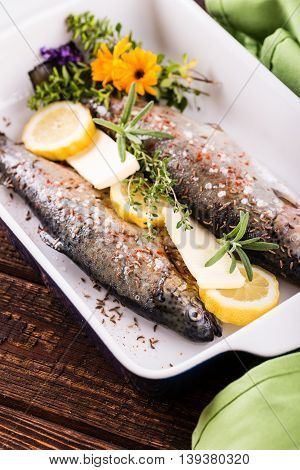 Trouts And Herbs With Butter And Lemon In Pan