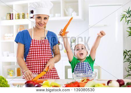 Happy Family Making Vegetables Vegetarian Meal