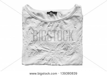 Folded white embroidered shirt on white background