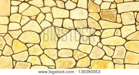 a one yellow background of stone wall