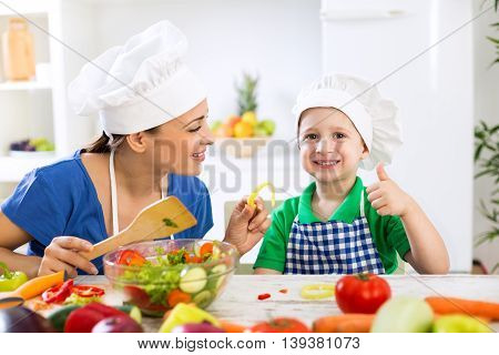 Family in kitchen eating fresh food in the kitchen